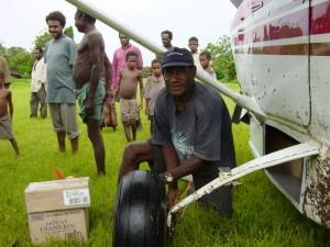 Waxe Christian unloading aircraft